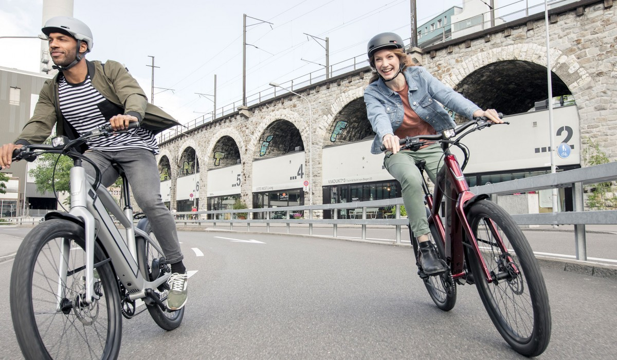 a man and a woman riding stromer bikes